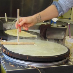 Spreading batter with crepe spatula