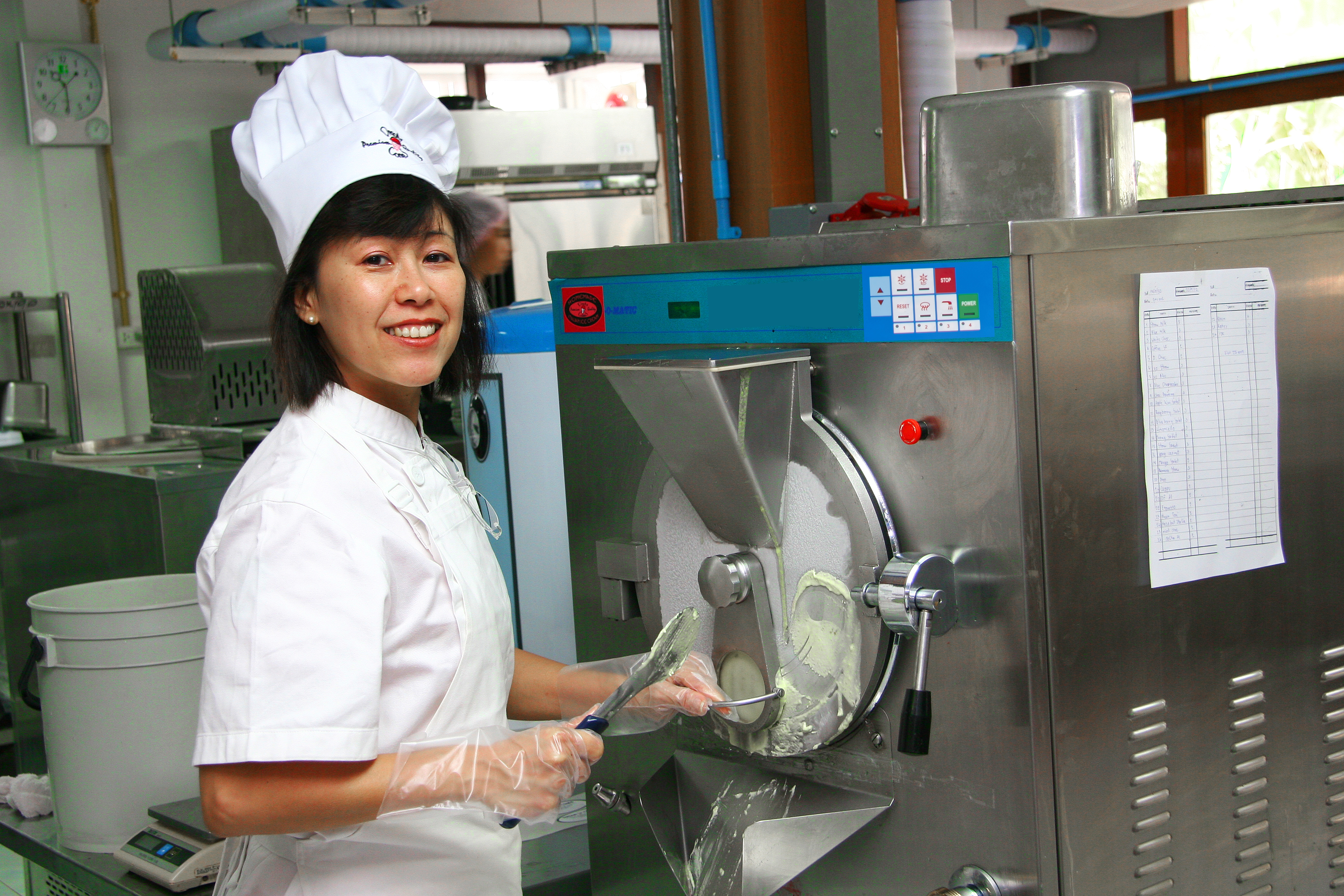 Ice Cream machine training: student working batch freezer